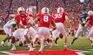 Can't get a grip: Huskers' title hopes are dashed by error-filled day