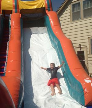 Kids take to the water slides on blistering Sunday
