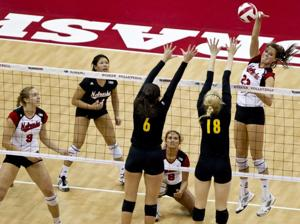 Robinson, Huskers serve up a sweep of Iowa
