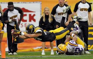Hill runs for 216 yards as LSU beats Iowa in Outback Bowl