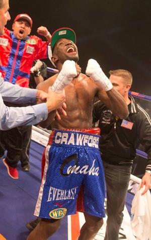 Crawford becomes Nebraska's first world champion boxer since 1914