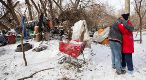 Volunteers venture out into the cold to help homeless