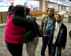 After 3 years, children arrive from Brazil to reunite with mother