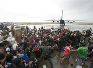 Desperate survivors seek to flee typhoon zone