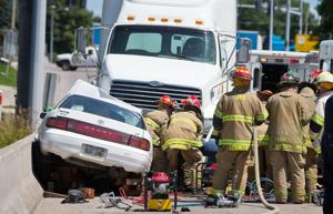 Woman injured after vehicle hits semitrailer truck in South Omaha