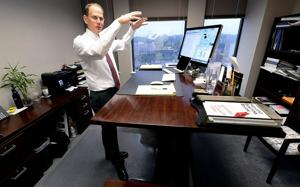 Workers trade chairs for standing desks, treadmills, even exercise balls