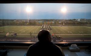 Steve Baker calls the plays as head of Elkhorn schools — and as football game announcer