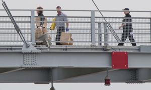Victim may have shot himself in fight on Bob Kerrey Pedestrian Bridge