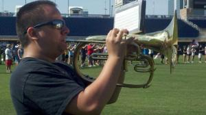 Rained out of 2012 CWS opening ceremonies, Lincoln S.E. band invited back this year