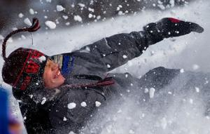Kids have a blast sledding; forecast for next storm: 3-6 inches of snow in metro area