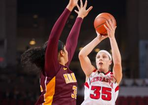 Hooper hits milestone as Husker rally to win
