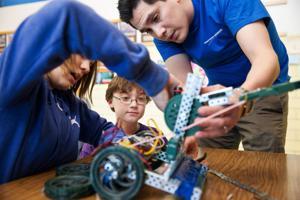 Budding engineers at Belle Ryan Elementary get help building robots from Northrop Grumman