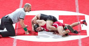Hawkeyes win tight matches to take dual