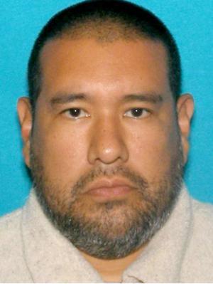Suspect Anthony Garcia's behavior struck hotel clerk as peculiar