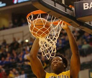 <p>Caleb Swanigan of Homestead dunks against Reitz, 4th quarter Saturday at the 4A state finals.</p>
