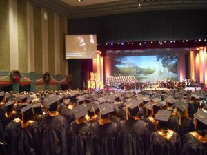 Graduates sing along to