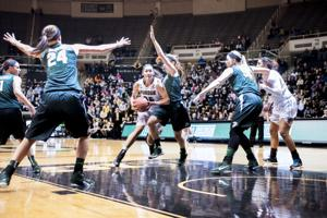 <p>Redshirt senior Whitney Bays drives the ball to the basket against Michigan State on Saturday in Mackey Arena.</p>