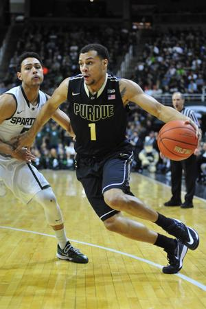 <p>Sophomore Bryson Scott attacks the basket during the first half against Michigan State on Wednesday at Breslin Center, East Lansing, Michigan. Purdue drops the game, 72-66.</p>