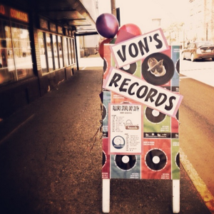 <p>A sign stands outside Von's Shops welcoming the community to Annual Record Store Day of 2014.</p>
