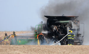 Fire destroys combine but kept from spreading through fields
