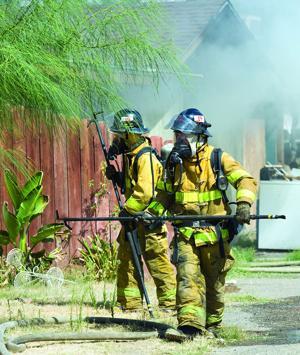 firefighters battle a structure fire