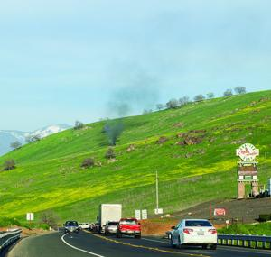 <p><strong>A column of black smoke rises into the sky near Highway 190 near the Eagle Feather Trading Post after a Tulare County Sheriff's Department aircraft crashed into the hillside south of the road on Wednesday, killing two.</strong></p><div><span><strong></strong></span></div>