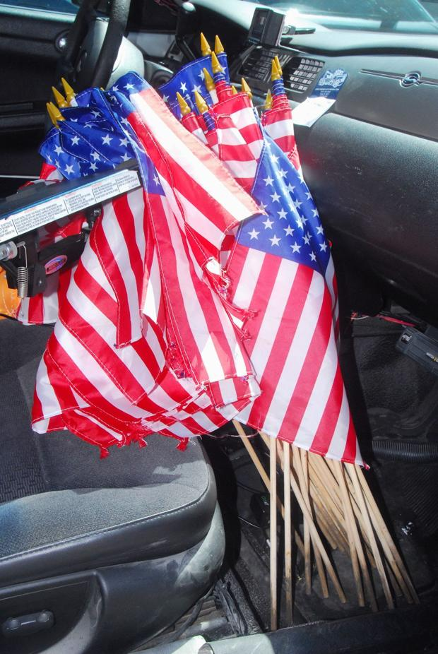 American flags found discarded in ditch
