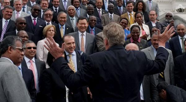 <p>Virginia Governor Terry McAuliffe, back to camera, invites a group of more than 60 Ambassadors to lunch at the Executive Mansion after a photo op outside the State Capitol in Richmond, VA Thursday, May 28, 2015.</p>