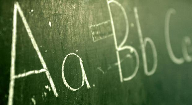 <p>Alphabet written on chalkboard</p>