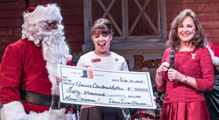 <p>Donna Meade Dean-Stevens (right), widow of Jimmy Dean, presents a $50,000 check for the Henrico Christmas Mother program to Beverly Cocke and Lee Blasingame at the Old Dominion Barn Dance at the Henrico Theatre.</p>