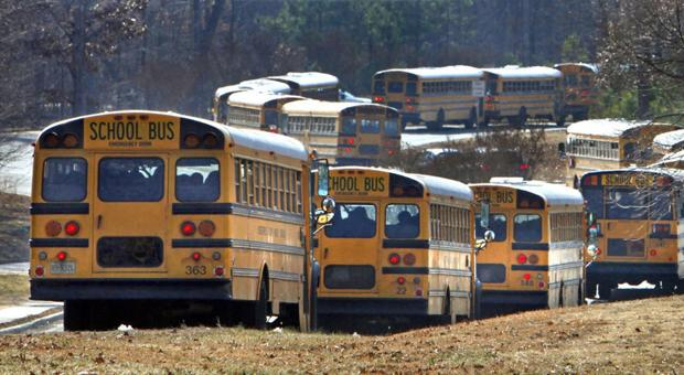 <p>Buses head out from James River High School at the end of the school day.With over 45,000 students who ride 500 buses, Chesterfield County is considering reworking its bus routes with the help of an automated, computerized route system.</p>