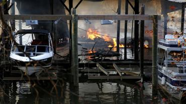 <p>The fire at the Richmond Yacht Basin on Friday destroyed or damaged 12 to 15 boats. About 60 boats are kept at the marina, many of which are yachts.</p>