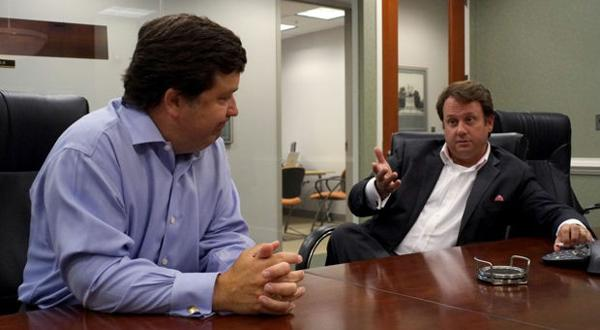 <p>Robert J. Hilb, left, founder and chief executive officer ot The Hilb Group, LLC insurance brokerage, and Jason S. Angus, right, chief marketing officer, confer during a meeting in their offices in Richmond, VA Friday, July 17, 2015.</p>