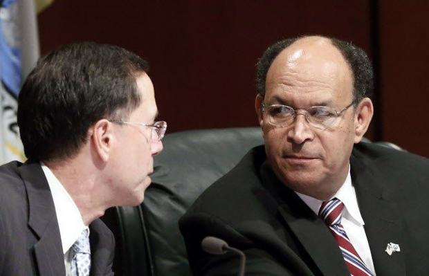 """<p>Chesterfield County Administrator James J.L. Stegmaier spoke to Board of Supervisors member James M. """"Jim"""" Holland during a public hearing in March 2014.</p>"""