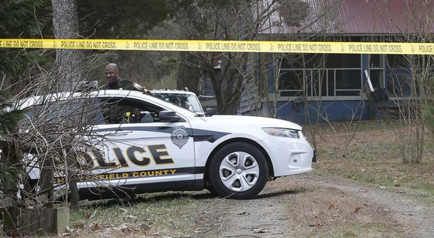 <p>Police tape covered the entrance to a property in the 8300 block of River Road in Chesterfield County, west of Matoaca, where a woman's body was found Thursday behind the home.</p>