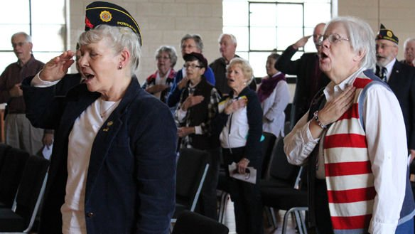 "<p align=""right"">Top left, attendees at American Legion Post #201's Veterans Day program sing the National Anthem on Nov. 11.</p>"