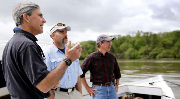 <p>James River Association CEO Bill Street (left) talks with the EPA's Jeff Corbin and Rich Batiuk before touring the James.</p>