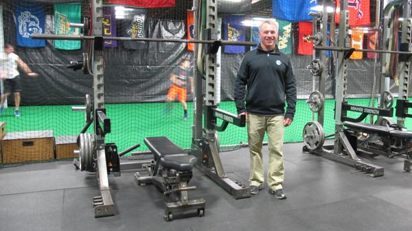 <p>Jason H. Elkin stands at one of the weight stations at Elkin Sports Performance, a training facility he recently moved to the Rockit Sports complex at 3001 E. Paraham Road, doubling his space to 6,000 square feet.</p>