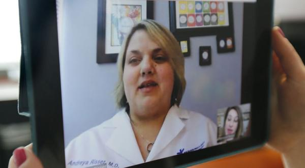 <p>Dr. Andrea Risser M.D. is shown in an online doctor's visit.</p>