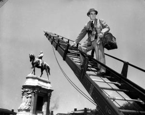 HIGHER THAN LEE?--Ewing Krainin is the only person in Richmond to look down on General Lee...and he's only doing it for business reasons.  Here to do a series of pictures on Richmond for a national magazine, Krainin has had to enlist the aid of the Fire D