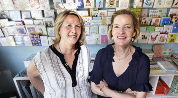 <p>Carol Watt (left) is buying Paper Plus from Beth Clough (right).</p>