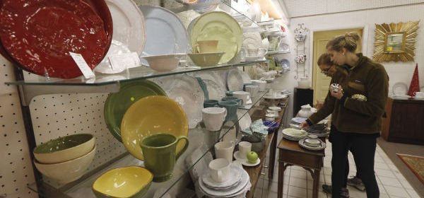 <p>Tyler Mitchell (foreground) of Charleston, SC and her mother Betsy Mitchell of Richmond look over pieces in the china gallery as J. Taylor Hogan is closing after 62 years of selling fine china, silver and gifts on Libbie Avenue.</p>