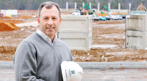 <p>Mark J. Hourigan, president of Hourigan Construction, photographed at the construction site for Dominion's new opersation center in Henrico County VA Thurs. Jan. 15, 2015</p>