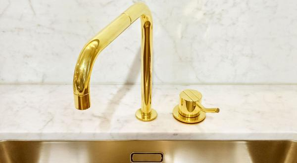 <p>Adding gold elements, whether with a faucet, hood, lighting fixture or range knobs, is an easy way to add glamour to your kitchen.</p>