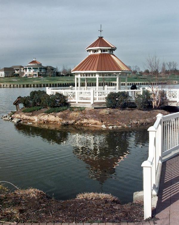 <p>The lake at Wyndham photographed Monday, March 13, 2000. The Dominion Club is across the lake from the gazebo.</p>