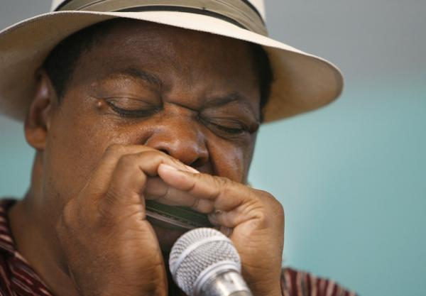 <p>Phil Wiggins plays at the Smithsonian Folklife Festival in Washington, D.C. on 6/27/07. Wiggins was born in Washington, DC in 1954.</p>
