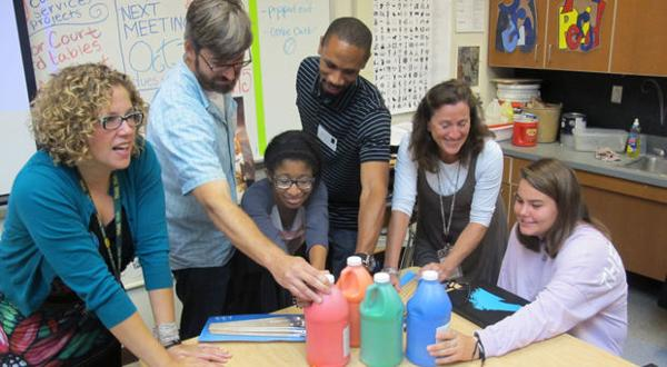 <p>Students and teachers at Douglas Freeman High School join with artists to check out supplies for a mural project for the Regency Square shopping center. From the left are teacher Rebecca Field, artist Matt Lively, student Paigen Stoudmire, teacher Taylor Baker-Neal and student Nicole Cametas.</p>