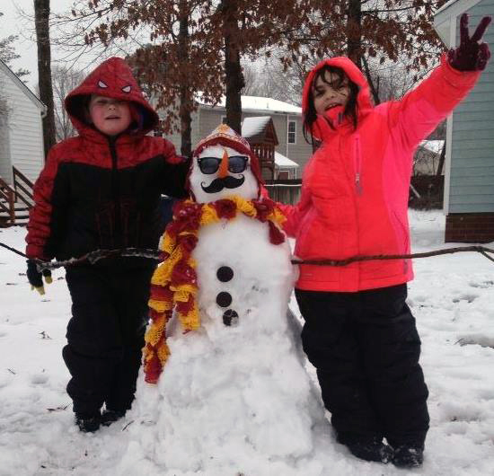 Kids making their first snowman ever!