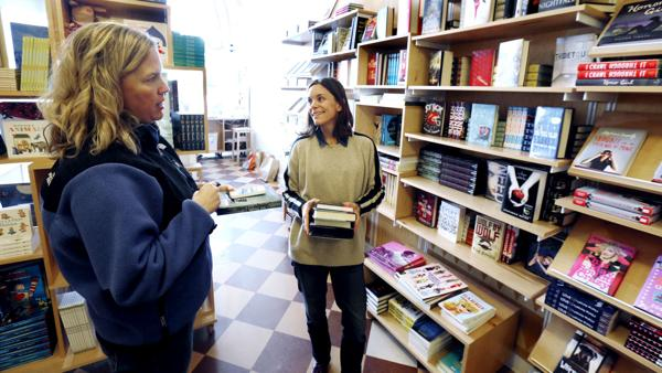 <p>Jenesse Evertson, C, co-owner of bbgb bookstore in Carytown, makes children reading suggestions to customer Cara McDaniel of Richmond.</p>