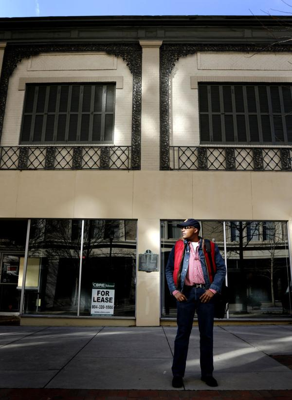 <p>Micheal Sparks stands in front one of the empty locations he's converting to a retail pop-up along Grace St. in Richmond</p>